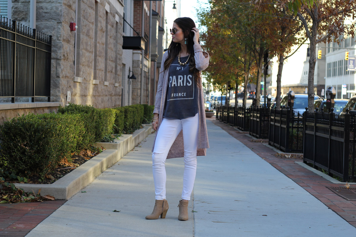Long cardigan and Paris graphic top and white skinny jeans