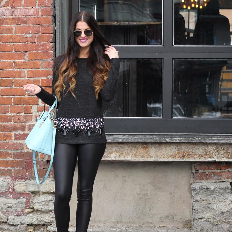 Sequin top and leather leggings and Henri Bendel purse
