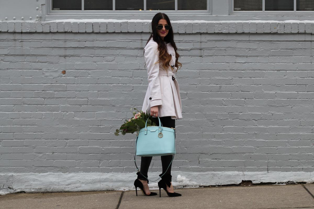 White coat and leather leggings and bow heels and Henri Bendel purse
