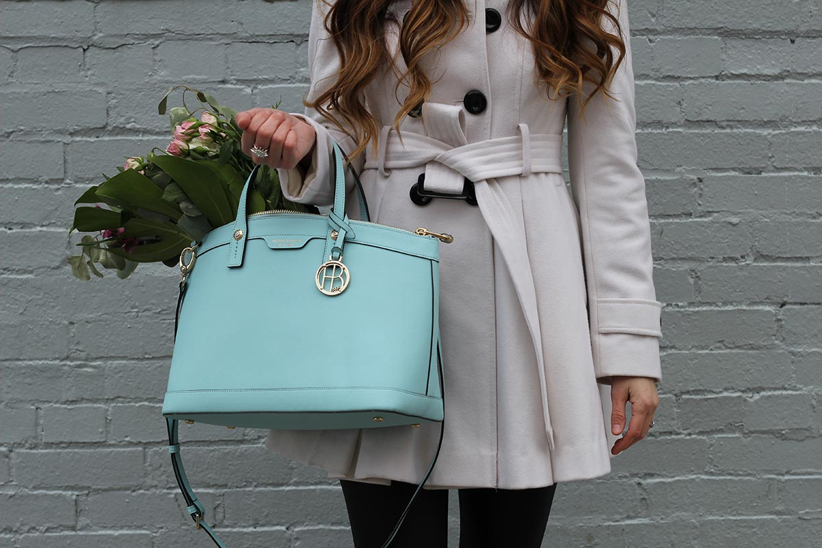 White coat and leather leggings and Henri Bendel purse