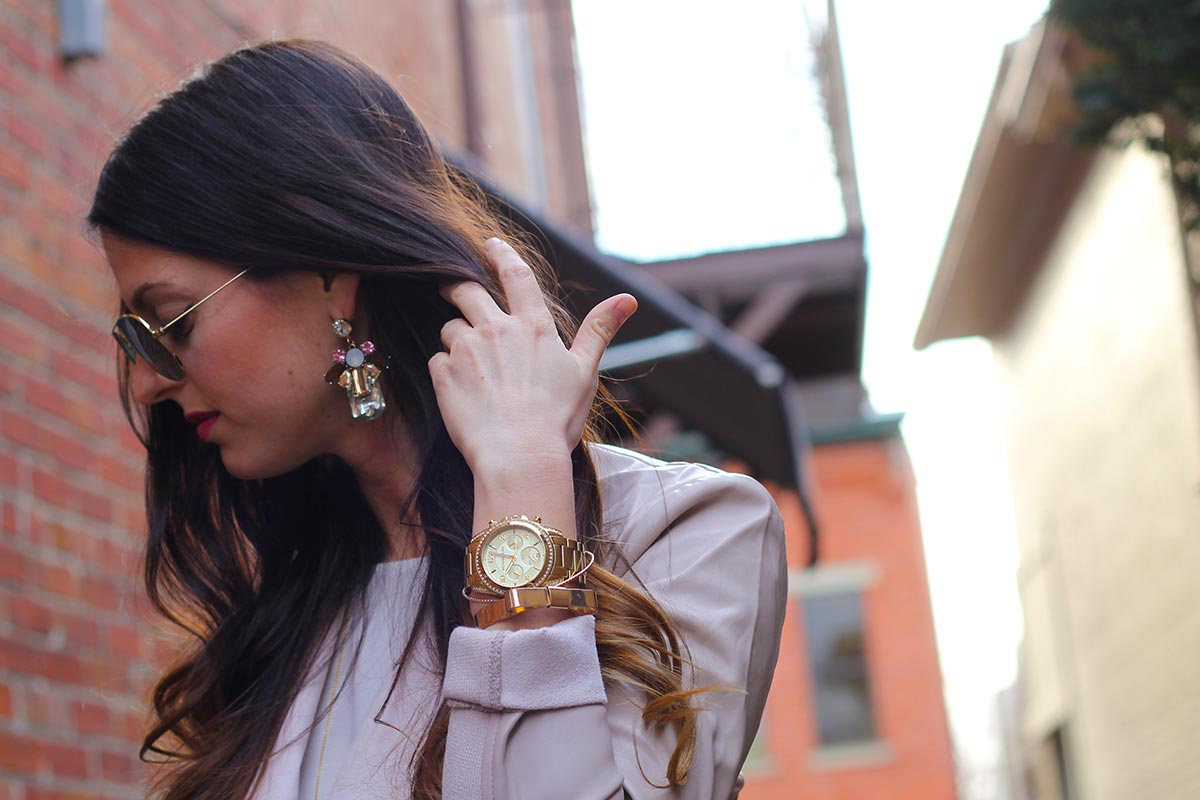 Leather jacket and Marc Jacobs watch and statement earrings