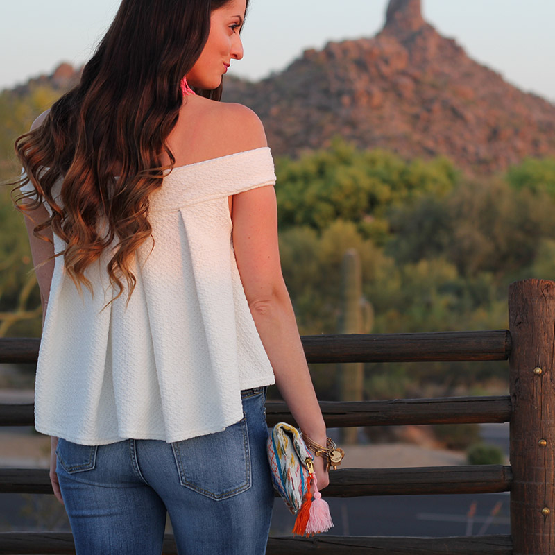 White Off-the-Shoulder Top and Colorful Clutch